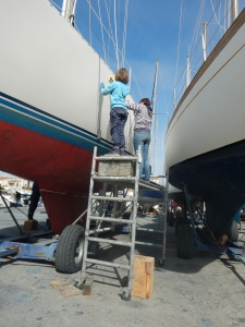 Milly and Heather removing the UV damaged stripes
